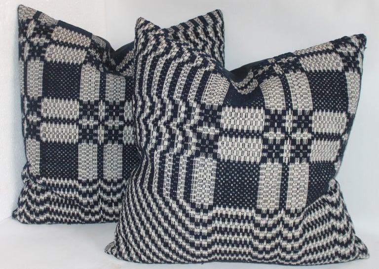 These four jacquard coverlet pillows are in fantastic condition and have blue cotton linen backings. The inserts are down and feather fill.