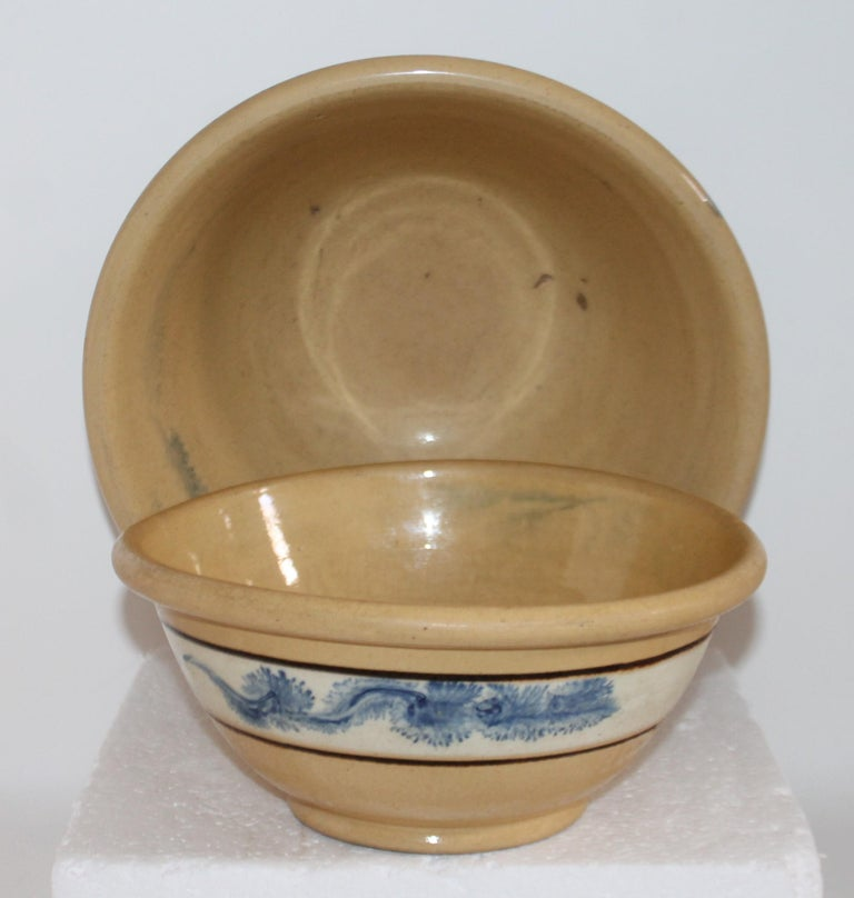 Adirondack 19th Century Yellow Ware in Seaweed Pattern Mixing Bowls, Pair For Sale