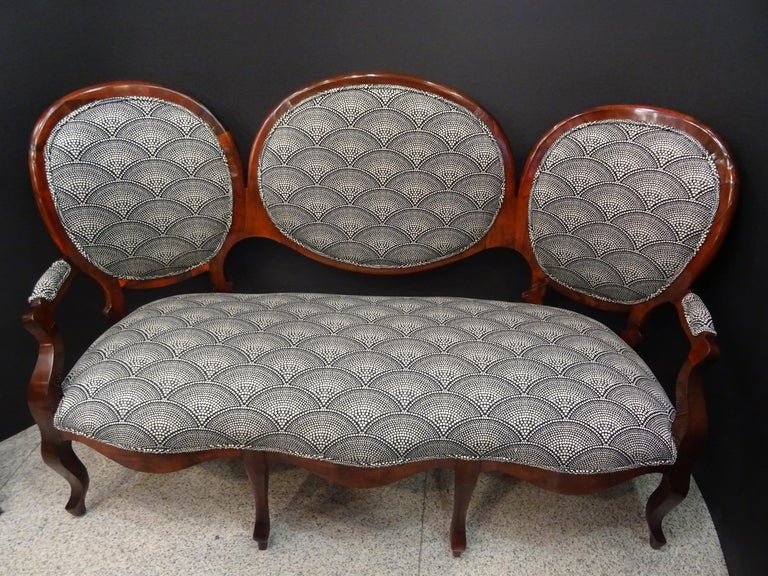 Stunning Napoleon III French canapé in walnut wood and newly upholstered with
