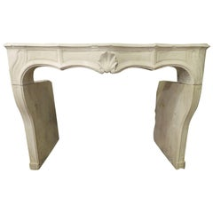 19the Century Hand-Carved Louis 15 Fireplace in Limestone