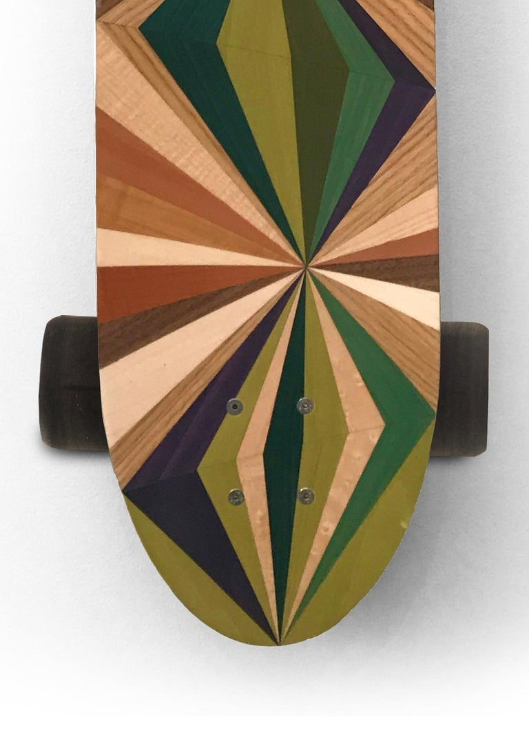 The w o o d p o p pintail longboards are handcrafted in workshops on either side of the Welsh/English border the UK. Each one is made from best quality Finnish Birch and vacuum laminated to form a concave deck featuring a unique marquetry inlay