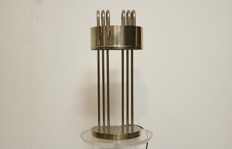A semi-circle top table lamp by Marcel Breuer. They are the first edition of Marcel Breuer lamps. They are stamped with numbers only, contrary to the ones marked