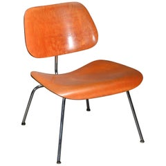 First Edition Evans Red Analine Lcm Chair by Charles and Ray Eames