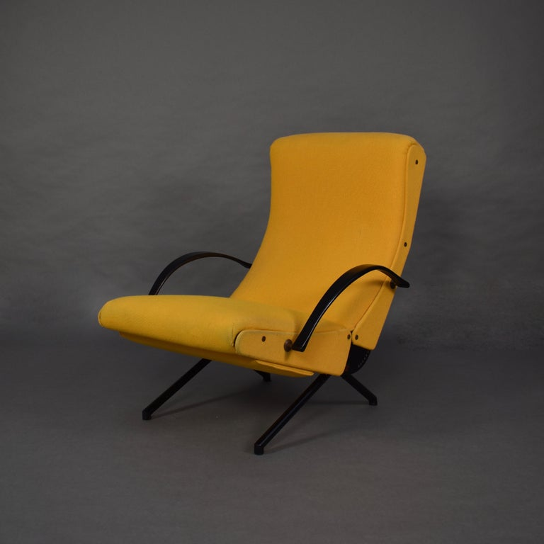 First edition p40 lounge chair by Osvaldo Borsani for Tecno. The 1st edition model has no extractable headrest and a round tubular base. This chair even has the earliest brass two-hole screws and not the allen or phillips screws.  The P40 lounge