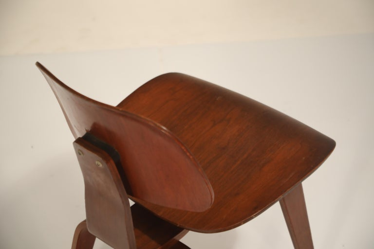 Walnut 1st Generation Charles Eames for Evans Products Company DCW Chair, 1947, Signed For Sale