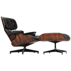 1st Generation Eames Chair and Ottoman in Rosewood