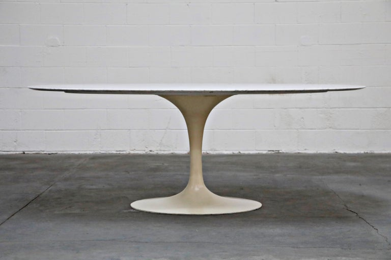 Often considered by designers and collectors as the pièce de résistance of marble dining tables, this 1st Generation, early production year (possibly 1st year of production), triple signed Knoll Associates white marble 'Tulip' dining table is the