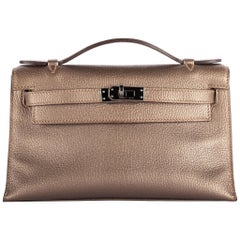 1stdibs Exclusive Hermès Kelly Pochette Metallic Bronze Chèvre Ruthenium