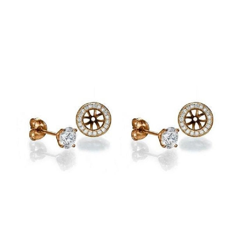 A beautiful Diamond stud earrings made of 14K Rose Gold set with a pair of excellent Round cut Diamond of SI1 clarity and F color accented by 40 natural round diamonds.The total carat weight of these Diamond studs is 2.46 carat.    Center Stone: