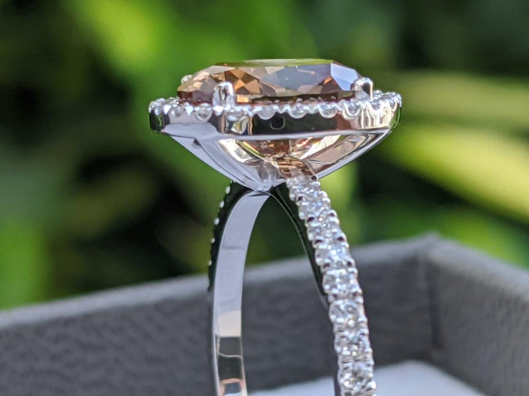 One Of A Kind Engagement Ring Fancy Orangy Brown Certified 2.50 carat Diamond Ring. Set in a sleek, platinum, solitaire ring with a 4-prong setting, this fantastic piece is guaranteed to delight for decades to come!   Mainstone details: Main Stone