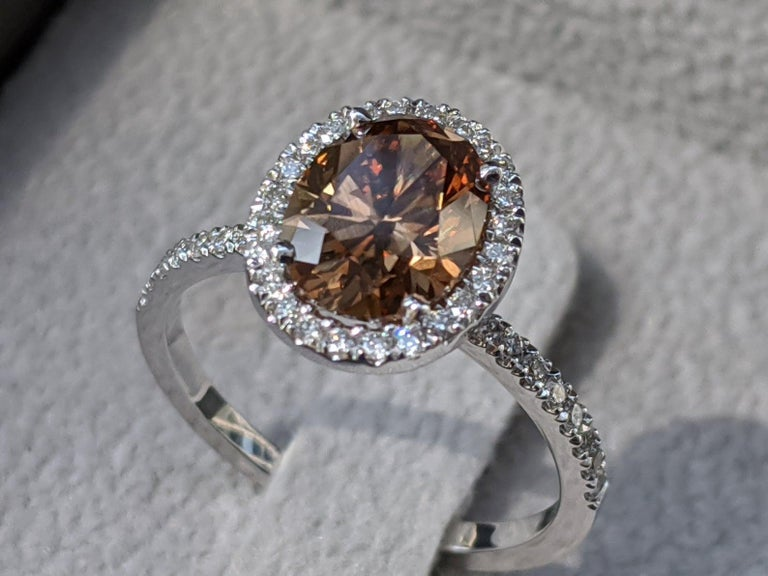 Oval Cut 2 1/2 Carat Platinum GIA Oval Orangy Brown Diamond Engagement Ring For Sale