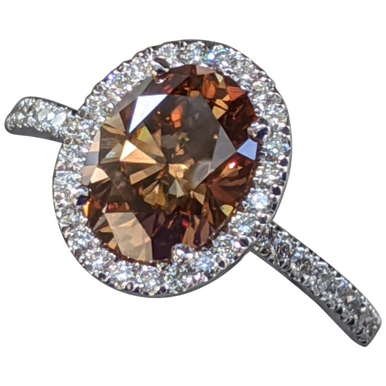 2 1/2 Carat Platinum GIA Oval Orangy Brown Diamond Engagement Ring For Sale
