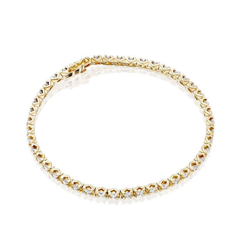 A beautiful large and classic diamond bracelet made of 14K Yellow Gold set with Natural Diamonds.bThe total carat weight of this beautiful Diamond bracelet is 2 1/2 carat, D-F color and VS clarity.      Metal Type:  This bracelet can be made in