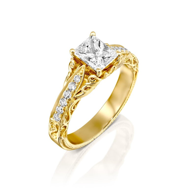This breathtaking Victorian style ring features a solitaire GIA certified diamond. Ring features a 2 carat radiant cut 100% eye clean natural diamond of F-G color and VS2-SI1 clarity and it is accented by diamonds of approx. 0.25 total carat weight.