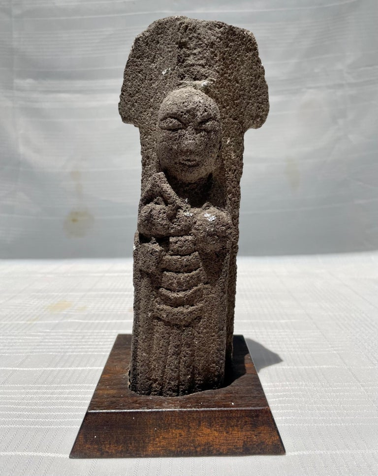 Antique 18th Century Japanese Jizo Bodhisattva Stone Carving.  A truly remarkable architectural stone fragment. The 18th century Japanese Buddhist divinity Jizo is hand carved from volcanic rock. The Jizo Bodhisattva is considered a protector of