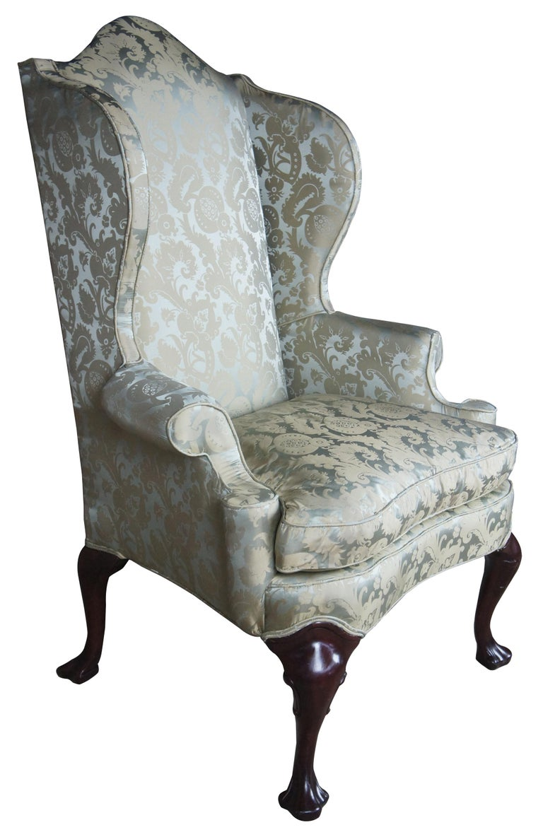 2 Antique Queen Anne Mahogany Wingback Arm Chairs Chippendale Damask Fabric  Queen Anne inspired wing-back armchair duo with Damask upholstery and cabriole legs in mahogany that lead to a trifid foot.