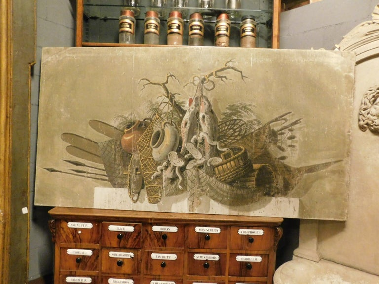 2 ancient paintings, canvases, hand painted by local artist from the 1800s in Italy, depict 2 still lifes, with hunting and fishing subjects, they were probably exposed above the fireplaces, suitable in any environment, from the most rustic, to the
