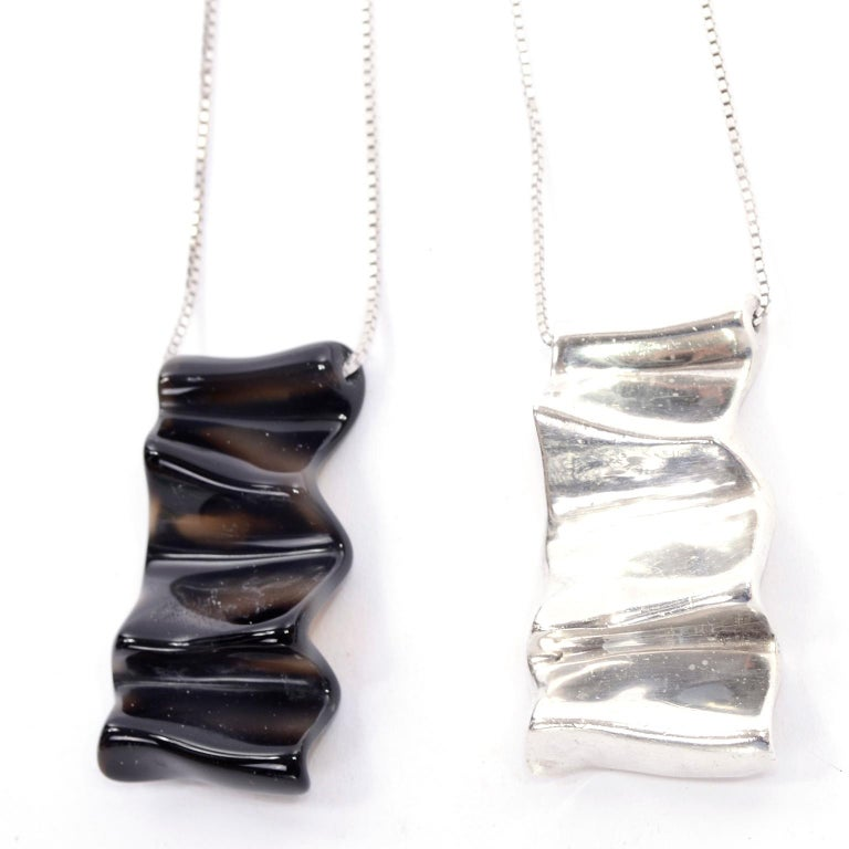 This is a beautiful pair of vintage pendant necklaces from modernist jewelry designers Jack Brusca and Joseph Dante. These one of a kind pieces were designed in the 1970's for a fashion executive who collected his jewelry. The pendants look like