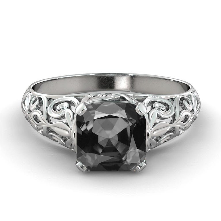 Beautiful vintage style black diamond ring. Center stone is 2 carats, natural, cushion shaped, AAA quality black diamond. Set in a sleek, 14K white gold, solitaire ring with a 4-prong setting, this fantastic piece is guaranteed to delight for