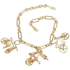 .02 Carat Diamond Emerald Yellow Gold Bicycle Themed Charm Bracelet