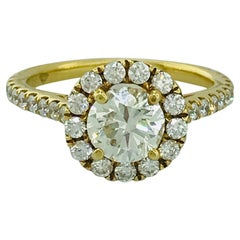 2 Carat Diamond Halo and Diamond Band Engagement Ring in 18 Karat Yellow Gold