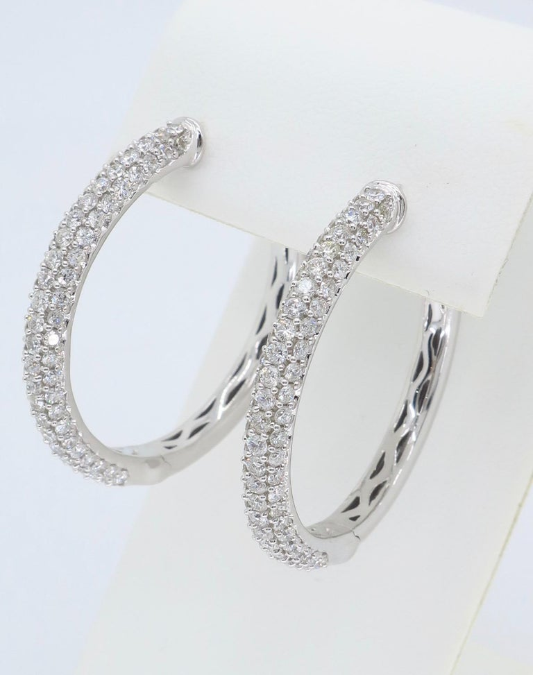These beautiful hoops feature approximately 2.33CTW of Round Brilliant Cut Diamonds.  Diamond Carat Weight: Approximately 2.33CTW Diamond Cut: 146 Round Brilliant Cut Diamonds Color: Average G-I Clarity: Average VS-SI Metal: 18K White
