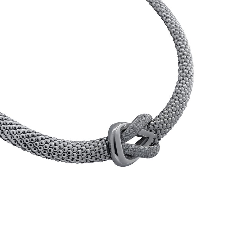 Spectacular omega mesh necklace crafted in 18 karat white gold featuring 68 round brilliant cut diamonds weighing approximately 2 carats total, G color VS clarity. The necklace culminates in a knot, one side of which is smooth, and the other is
