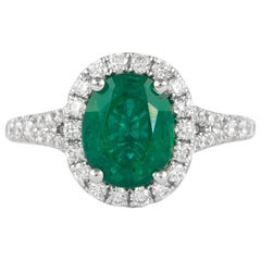 Alexander 2 Carat Emerald with Diamond Halo Ring 18 Karat White Gold