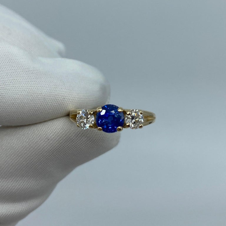 Fine Vivid Cornflower Blue Ceylon Sapphire & Diamond 14k Yellow Gold Three Stone Ring.  1.50 Carat centre sapphire with a fine quality vivid cornflower blue colour and very good clarity, a very clean stone with only some small natural inclusions