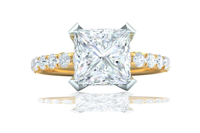 When you have a diamond which has the best color possible its important not to detract from its beauty.  That's exactly what this mounting does in keeping the center stone the focus.  The center diamond is a 2.01 carat Princess Cut GIA Certified