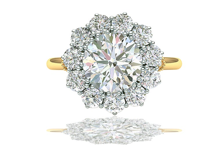 A stunning example of mid century bridal jewelry this ring stays true to that period. The center is a GIA Certified 2 Carat GIA Certified Round Brilliant Diamond set in a gorgeous platinum five prong halo. The halo has eleven 3 mm round brilliant