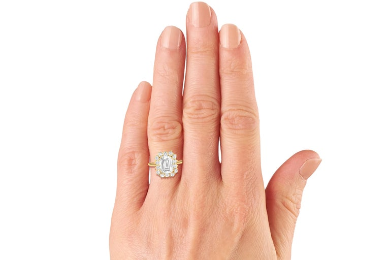 A stunning example of three prong engagement ring perfection.  The center stone is a GIA Certified 2 carat Emerald Cut K-VS2.  The center stone is accented by 3mm .10 carat each round brilliant diamonds which have a color and clarity of the center