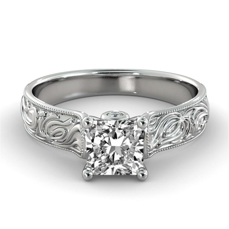 This breathtaking hand engraved vintage style ring features a solitaire GIA certified diamond. Ring features a 2 carat princess cut 100% eye clean natural diamond of F-G color and VS2-SI1 clarity accompanied by 2 smaller natural diamonds off approx.
