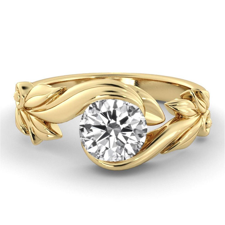 Unique vine leaf style setting GIA certified diamond engagement ring. Ring features a 2 carat round cut 100% eye clean natural diamond of F-G color and VS2-SI1 clarity. Set in a sleek, 18K yellow gold, solitaire ring with a 4-prong setting. The