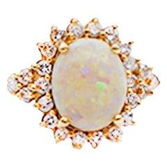 2 Carat Opal and Diamond Halo Ring 14 Karat Yellow Gold