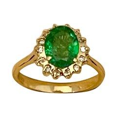 2 Carat Oval Cut Emerald & Diamond Ring in 18 Karat Yellow Gold
