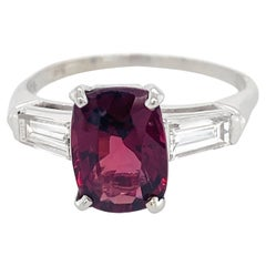 2 Carat Red Spinel Set in Classic Platinum 3-Stone Ring with Diamond Baguettes