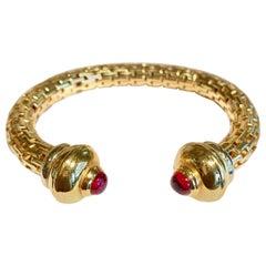 2 Carat Rubies 18 Carat Yellow Gold Serpenti Bangle
