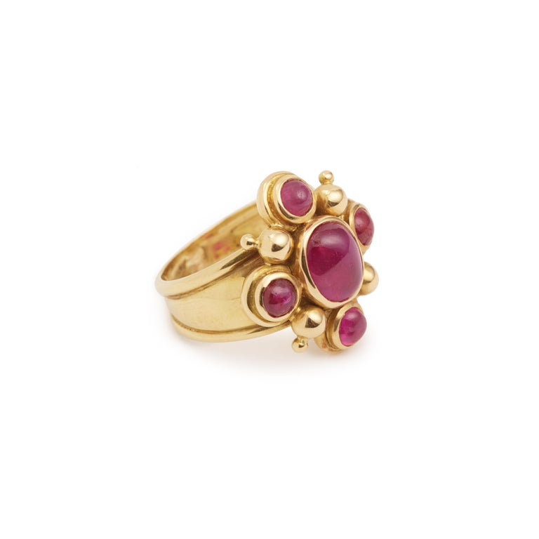 Original 18 carat yellow gold ring set with 5 rubies cabochon-cut.  Weight of the central ruby: 1.70 carats  Total weight of rubies: 2 carats  Dimensions of the ring : 2 x 1.85 x 0.65 cm ( 0.79 x 0.39 x 0.24 inch)  Finger size: 51 (US size: 5.5