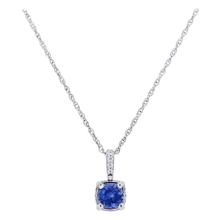 A clean and elegant matching necklace and earring set featuring a total of 2 Carats Cushion Cut Sapphires and Diamonds in the Necklace and Earring set created in 14K WG.  The pendant hangs on an 18
