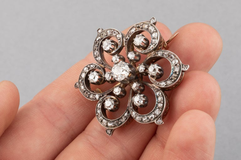 2 Carats Diamonds French Antique Brooch  Very beautiful Brooch, French made circa 1880. Craft in rose 18k and silver. Eagle head mark for gold 18k. The diamonds weights 2 Carats total estimate, the bigger one weights 0.60 carats estimate, Old