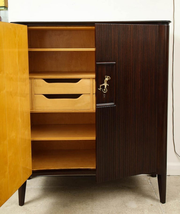 2-Door Cabinet by Osvaldo Borsani & Lucio Fontana for ABV.  Mahogany, bronze, maple, back-painted glass. Dark stained mahogany with fluted door-fronts & inset dark glass top. Interior of bleached wood with adjustable shelving and 4 drawers. Cast