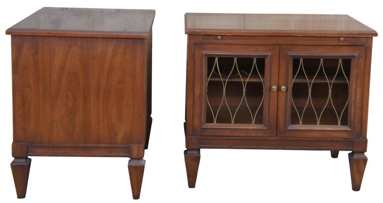 Circa 1960s Drexel Heritage Movanti Mediterranean collection nightstand/ side tables,14-172-30. Drawing inspiration from early Renaissance, Italian, classical and other European designs. A rectangular form made from fruitwood with brass grille doors