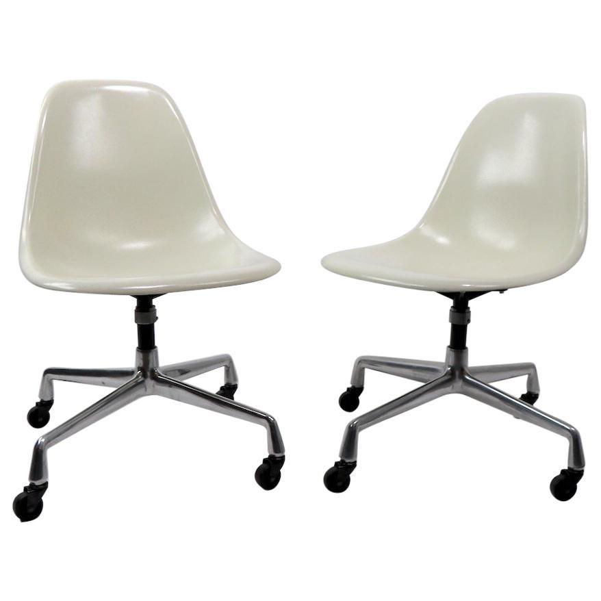 2 Eames Fiberglass Swivel Chairs on Aluminum Group Bases