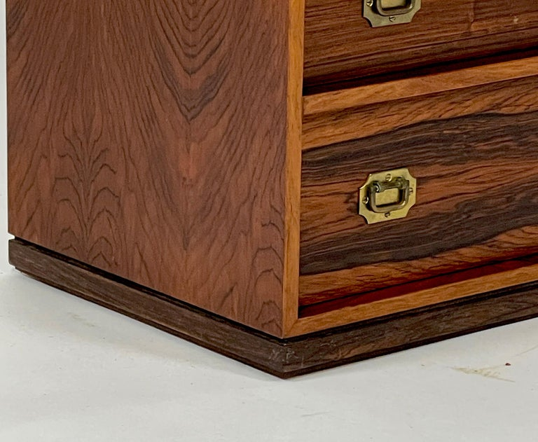 A beautiful petite rosewood campaign style jewelry chest designed by Henning Korch for Silkeborge Mobelfabrik. This particular piece has often been misattributed to Ole Wanscher in the past, but is actually by Henning Korch. The five drawers are