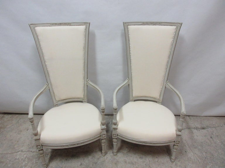 This is a set of 2 Gustavian style tall back armchairs, they have been restored and repainted with milk paints