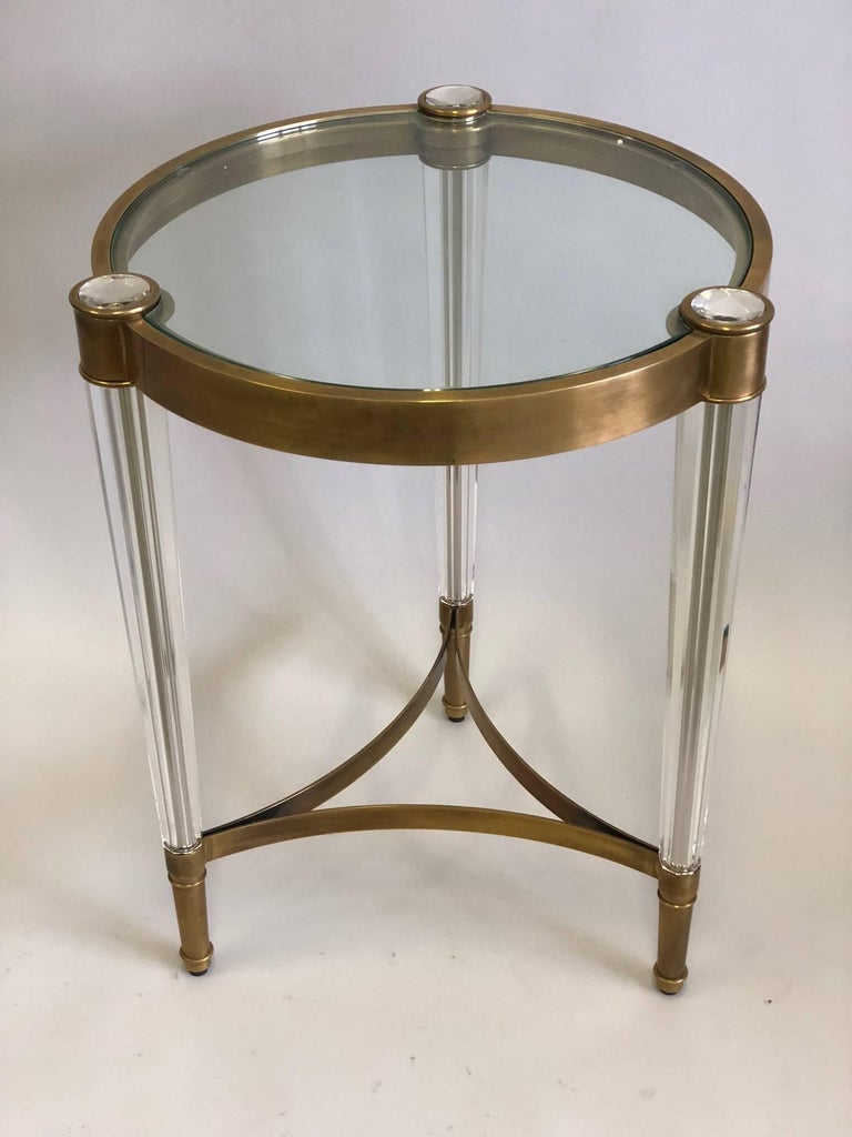 Pair of exquisite Italian Mid-Century Style End Tables in the Modern Neoclassical spirit and in the great tradition of Venetian glass making in furniture, rarely seen today. The tables are composed of solid lead crystal legs with a flawless, solid