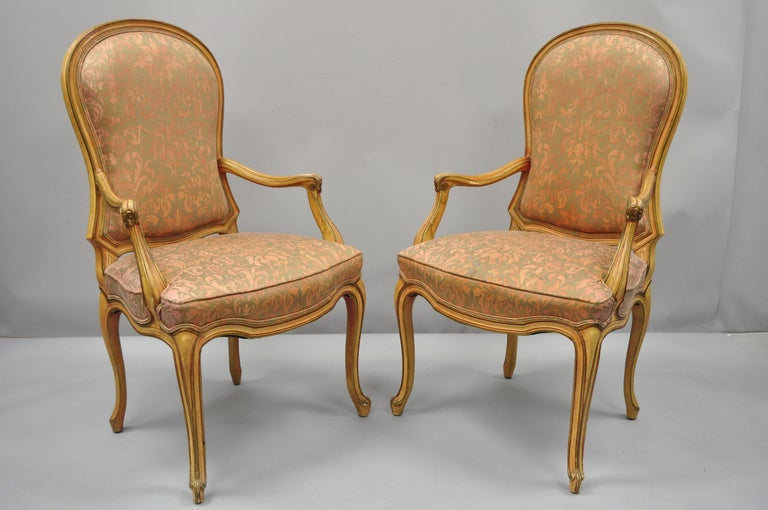 2 vintage Italian Provincial French Hollywood Regency style upholstered dining armchairs. Item features solid wood construction, upholstered back and seats, distressed finish, cabriole legs, quality craftsmanship, great style and form, circa
