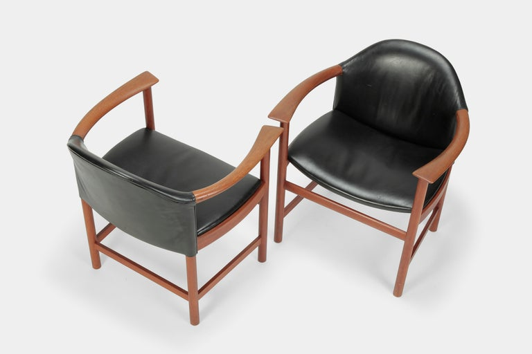 A beautiful pair of Kai Lyngfeldt Larsen armchairs made of solid teakwood frame and black leather by the company Soborg Moebler in the 1960s; model no: 508. In very nice vintage condition.