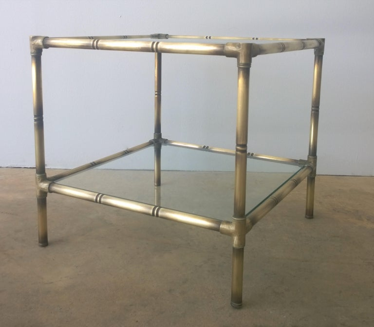 Offered are a set of two Mid-Century Modern Argentinian brushed brass faux bamboo and glass petite side / end / occasional tables. These little gems are quite lovely and uncomplicated. They would make a great addition to a space requiring pieces